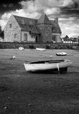 Ancient house and boats on a mooring - b&w Royalty Free Stock Photo