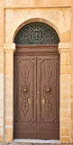 Ancient House Door, Malta. A medieval and ancient house door in Mdina on the island of Malta Royalty Free Stock Photos