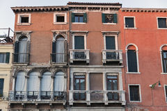 Ancient house facade at sunset in Venice, Italy. Royalty Free Stock Photography