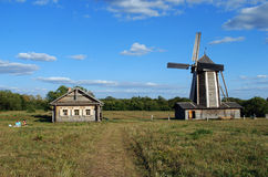 The ancient house from a felling and a windmill in the Lermontovsky memorial estate `Tarkhany` of the Penza region. Royalty Free Stock Photos