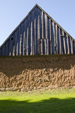 Ancient house with mole walls and wooden roof. Royalty Free Stock Image