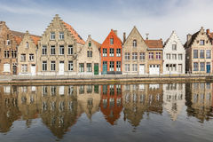 Ancient houses along a canal in Bruges. A line of ancient houses at a water canal in Bruges. West Flanders in the Flemish Region of Belgium Royalty Free Stock Photography