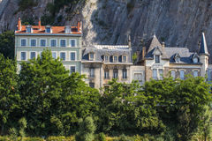 Ancient houses on the background of mountains in Grenoble, Franc Stock Photos