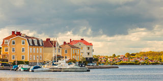 Ancient houses with boats in Karlskrona, Sweden. Panoramic image of ancient houses with boats in the seaside bay of Karlskrona, Sweden Stock Photo