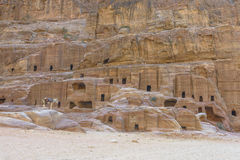 Ancient houses on Facade Street in Petra carved out of the rock Stock Photos