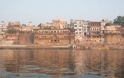 Ancient houses and Ganga river. Holy river of Ganga in Varanasi, Uttar Pradesh, India Royalty Free Stock Images