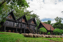 Ancient houses Thailand. Ancient black houses in Thailand Stock Photography
