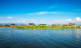 Ancient houses. And their reflection in the water on the Inle Lake, Myanmar Royalty Free Stock Images