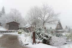 ancient houses and white snow is heavy and covered throughout  S Stock Photography