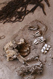 Ancient Human Bones. A pile of human bones in Chauchilla, an ancient cemetery in the desert of Nazca, Peru. The remains of many people, some still with long hair stock images