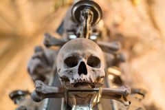 Ancient human skull and bone decoration in Sedlec, Czech republic. Kutna Hora Royalty Free Stock Photography