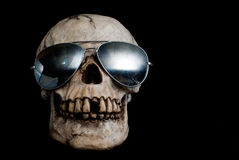 Ancient Human Skull Wearing Sunglasses Stock Image