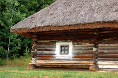 Ancient hut with a straw roof. Ancient traditional ukrainian rural cottage with a straw roof Stock Photo