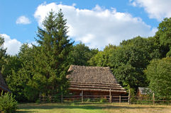 Ancient hut with a straw roof. Ancient traditional ukrainian carpatian cottage with a straw roof Stock Image