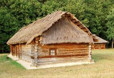 Ancient hut with a straw roof. Ancient traditional ukrainian rural cottage with a straw roof Stock Photography