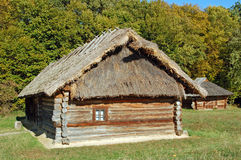 Ancient hut with a straw roof. Ancient traditional ukrainian rural cottage with a straw roof Stock Image