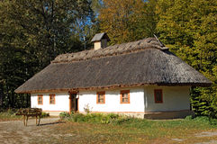 Ancient hut with a straw roof stock photography