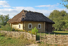 Ancient hut with a straw roof. Ancient traditional ukrainian rural cottage with a straw roof Royalty Free Stock Images