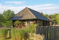 Ancient hut with a straw roof. Ancient traditional ukrainian rural cottage with a straw roof Royalty Free Stock Image