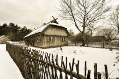 Ancient hut winter scene Stock Images