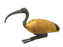 Ancient ibis statuette isolated. Ancient Egyptian carved and painted wooden statuette of a bird known as an ibis. Isolated on white royalty free stock photos