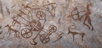 Ancient images on the wall of the cave ocher. Archeology Stock Images