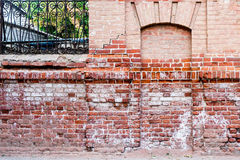 Ancient immured door in the red brick wall Royalty Free Stock Photo