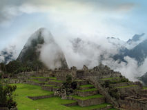 Ancient Inca lost city Machu Picchu. Peru. Structure architecture of temple complex Machu Picchu: guard houses, agriculture terraces and surrounding mountains in Royalty Free Stock Photo