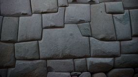 Ancient inca stone wall in the city of Cusco, Peru royalty free stock images