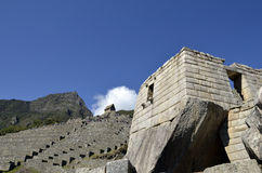 Ancient Inca Sun Temple on Machu Picchu. With Terraces and  Blue Sky in the Background Royalty Free Stock Photos
