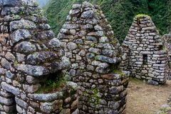 An ancient Inca town on the Inca trail. Ancient stone ruins of an Inca town on the Inca Trail in the Andes mountains. Cusco. Peru. South America. No people stock photos