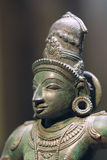 Ancient India bronze statue. The head close-up of ancient India bronze god statue Royalty Free Stock Photography