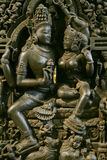 Ancient Indian sculpture. An ancient Indian sculpture with many figures in bronze stock photos