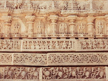 Ancient Indian Stone Carvings. A Temple Wall in South India Carved in Intricate Detail Illustrating Historical Events royalty free stock photo