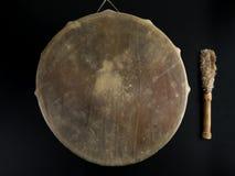 Ancient indian tambourine drum drumstick replica. Beautiful copy of old vintage indian tambourine buben drum with drumstick Stock Photography