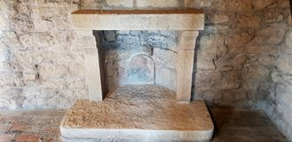 Ancient indoor chimney. An ancient chimney inside a fantastic castle in San Marino fort royalty free stock photos