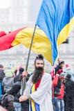 Ancient inhabitants of Dacia (ancient Romania) waving flag at th Royalty Free Stock Image
