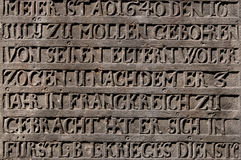 Ancient inscription. In German carved in stone on the wall of the church in Germany Royalty Free Stock Photo