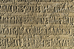 Ancient inscription. In the courtyard of an old church, there are some old stones in a language unknown Royalty Free Stock Photos