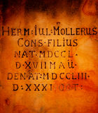 Ancient inscription in Latin. Carved in stone on the wall of the church Royalty Free Stock Photo