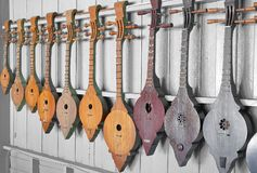 Ancient instrumental. Southeast asian style lute instrumental hang on white wall Stock Image