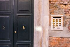 Ancient intercom in Venice with golden buttons, Italy royalty free stock photos