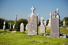 Ancient irish christian cemetery, tombstones together Royalty Free Stock Images