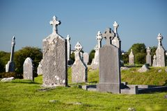 Ancient irish christian cemetery, tombstones together Stock Photo