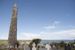 Ancient Irish round tower and celtic graveyard Royalty Free Stock Photography