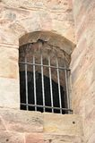 Ancient iron barred window. Of old castle Royalty Free Stock Images