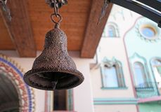 Ancient iron bell on the background of a wooden structure stock images