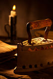 Ancient Iron with Candle Royalty Free Stock Photos