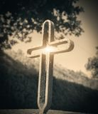 Ancient iron cross. At sunset royalty free stock images