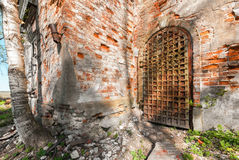 Ancient iron door decorated with wrought-iron details. Entrance to the abandoned russian church Royalty Free Stock Images